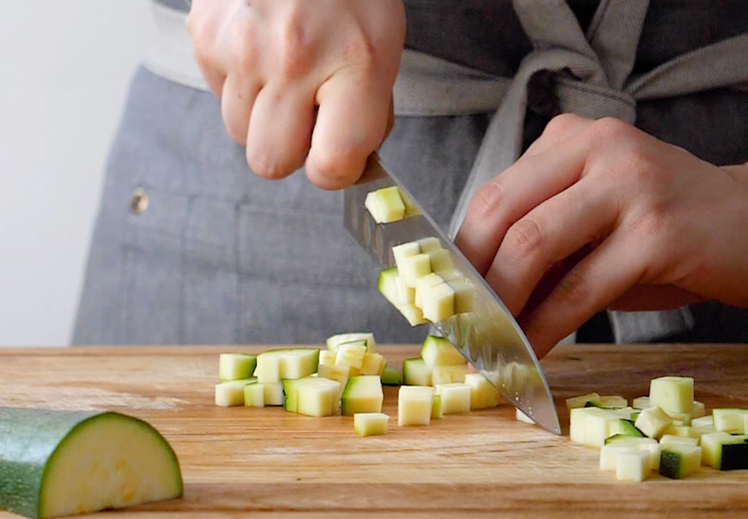 chef chopping a courgette