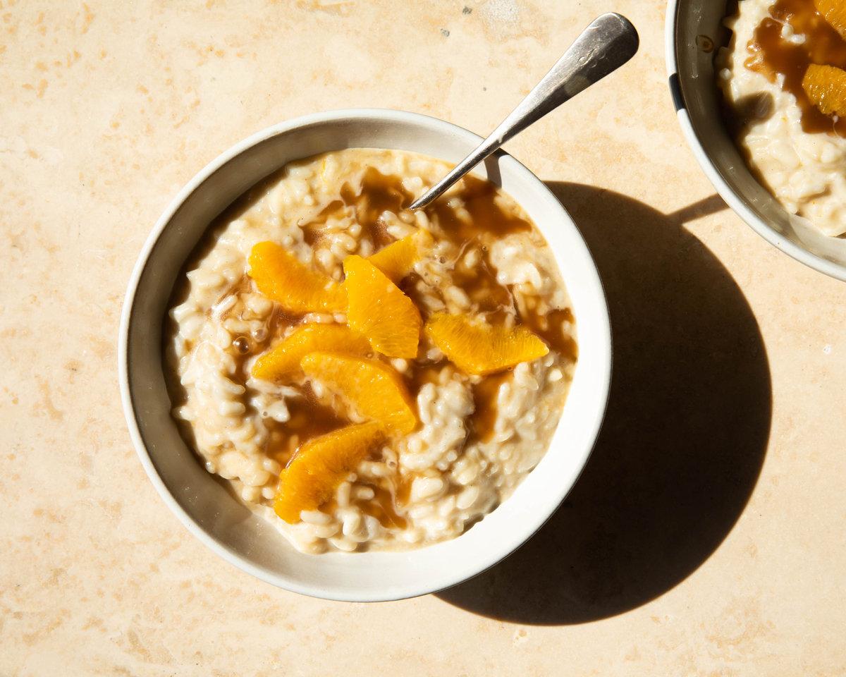 vanilla rice pudding in bowl with orange segments