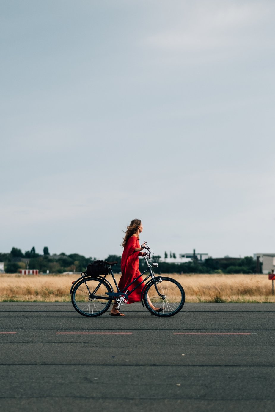 woman in red with bike