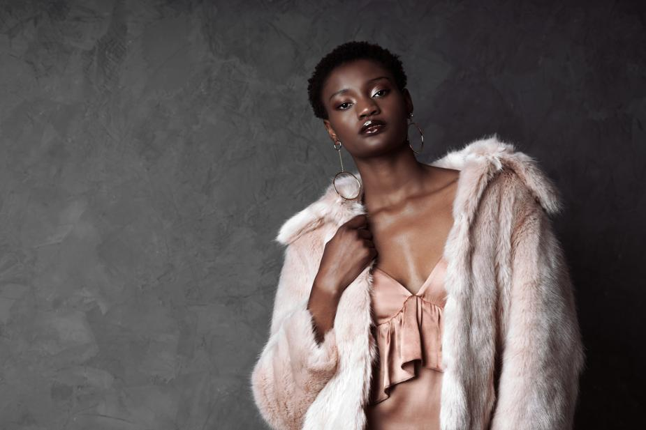model wearing pink faux fur coat