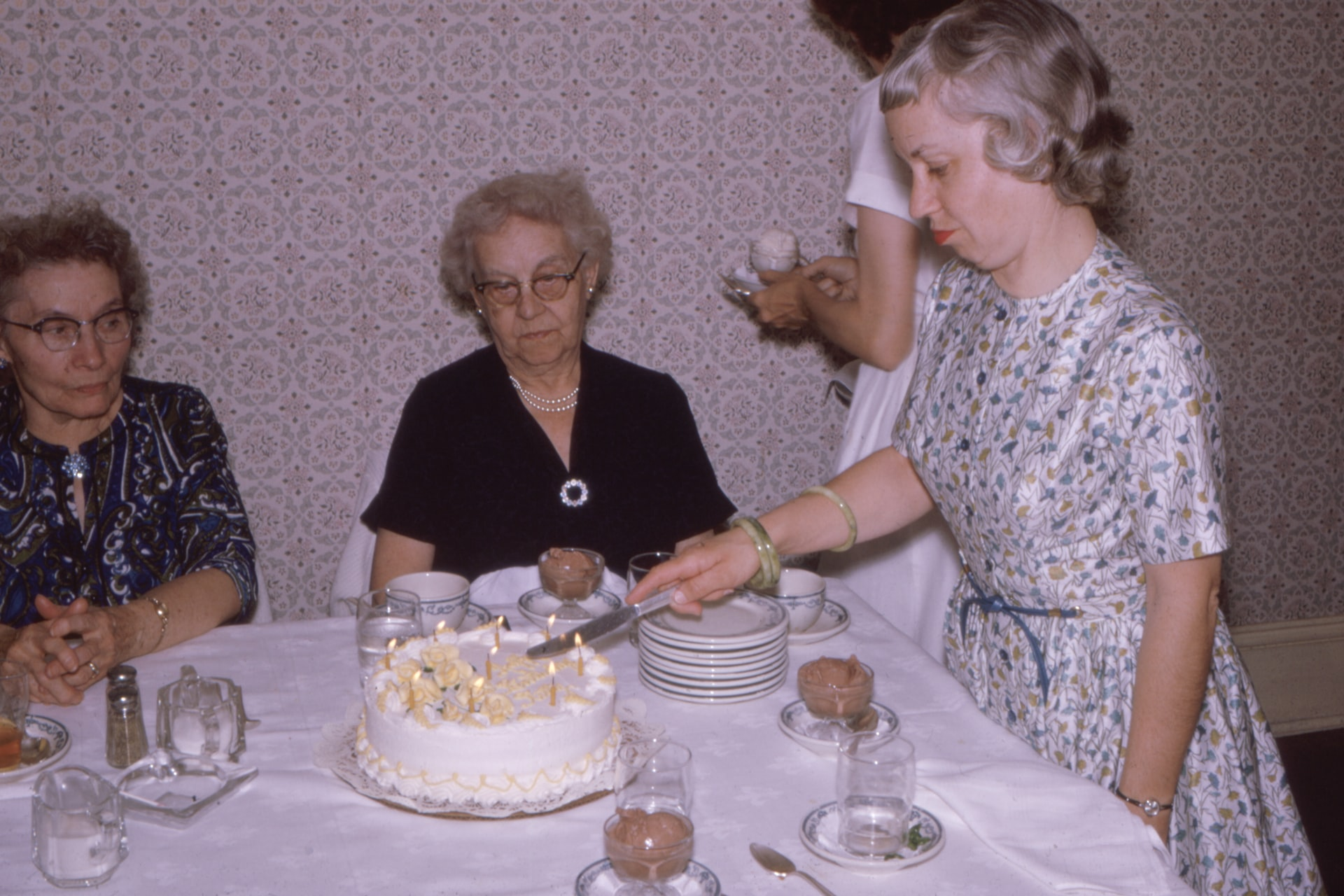 vintage photo of family with birthday cake
