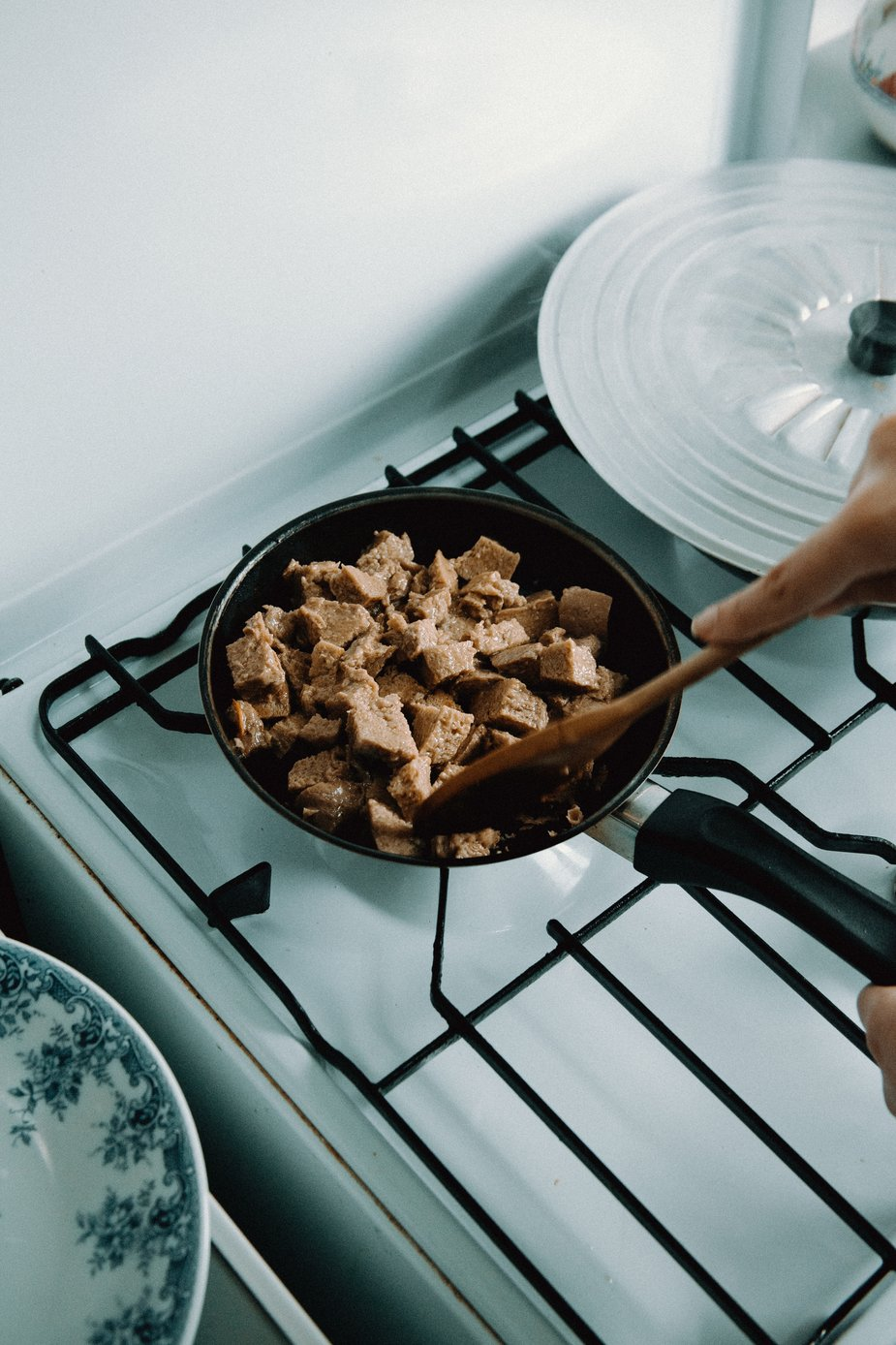 mixing plant-based meat on the stove