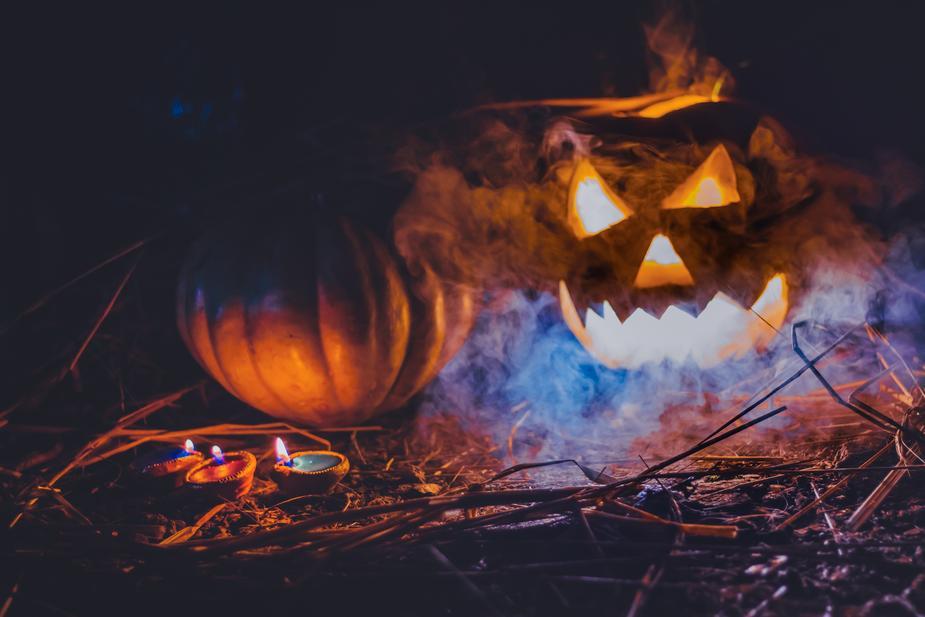 spooky pumpkins with light and smoke