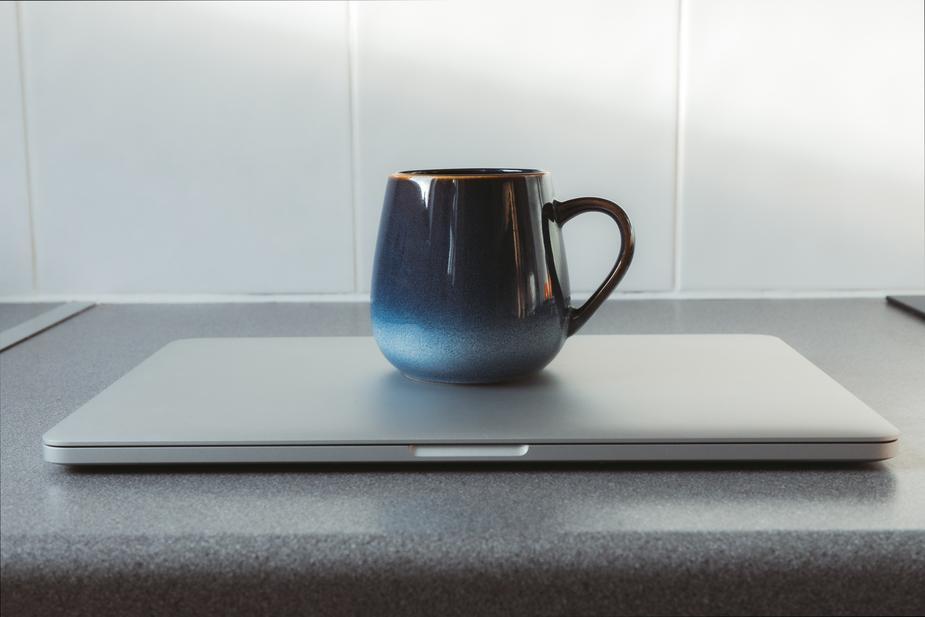 mug on closed laptop