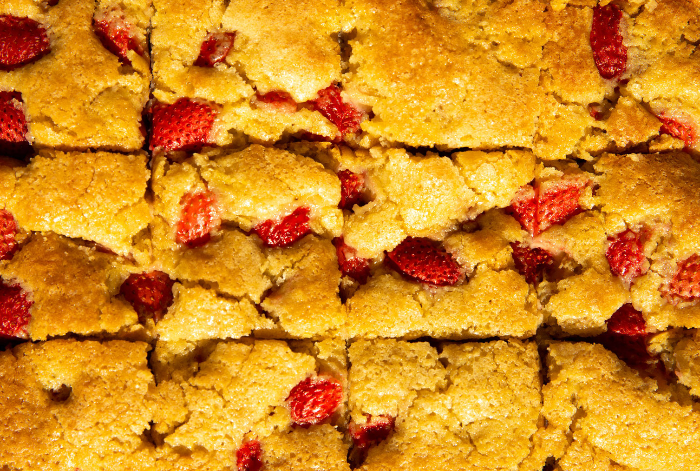 strawberries on sliced cake