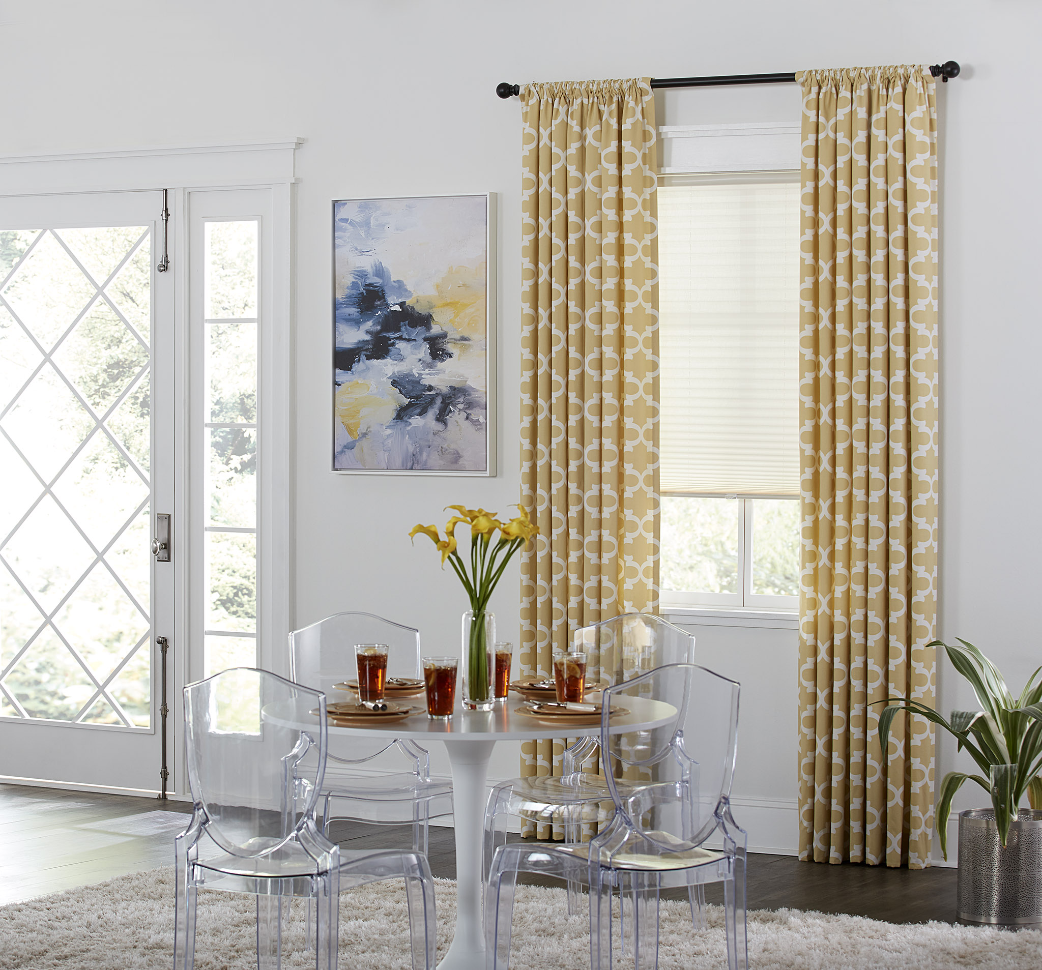 contemporary entryway with yellow draperies and beige cellular shades in the window.