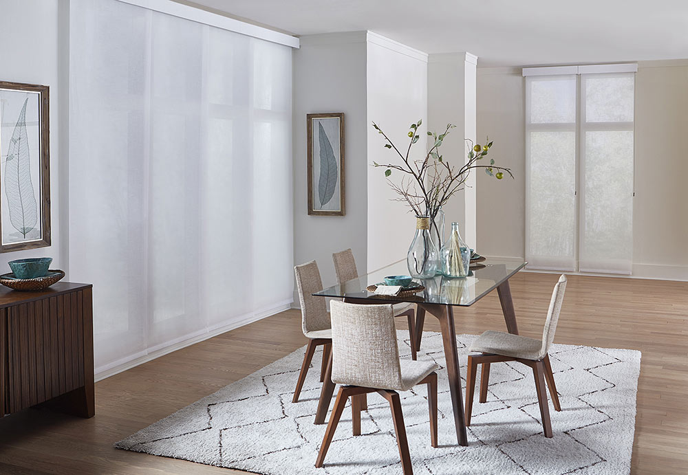 Contemporary Dining room with beige furniture and white solar shade sliding panels over the wall of windows.
