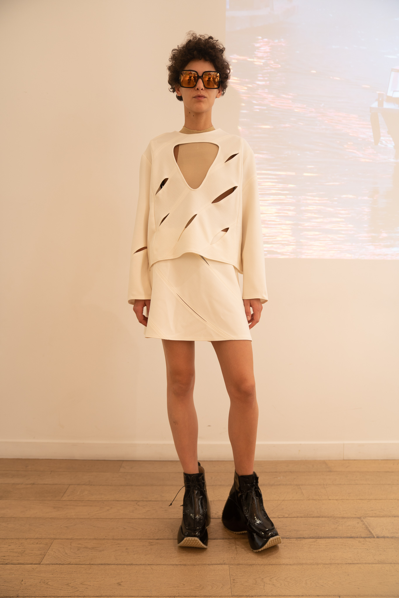 Courreges Cutout Multi Slit Jumper in White Skirt in White SS20