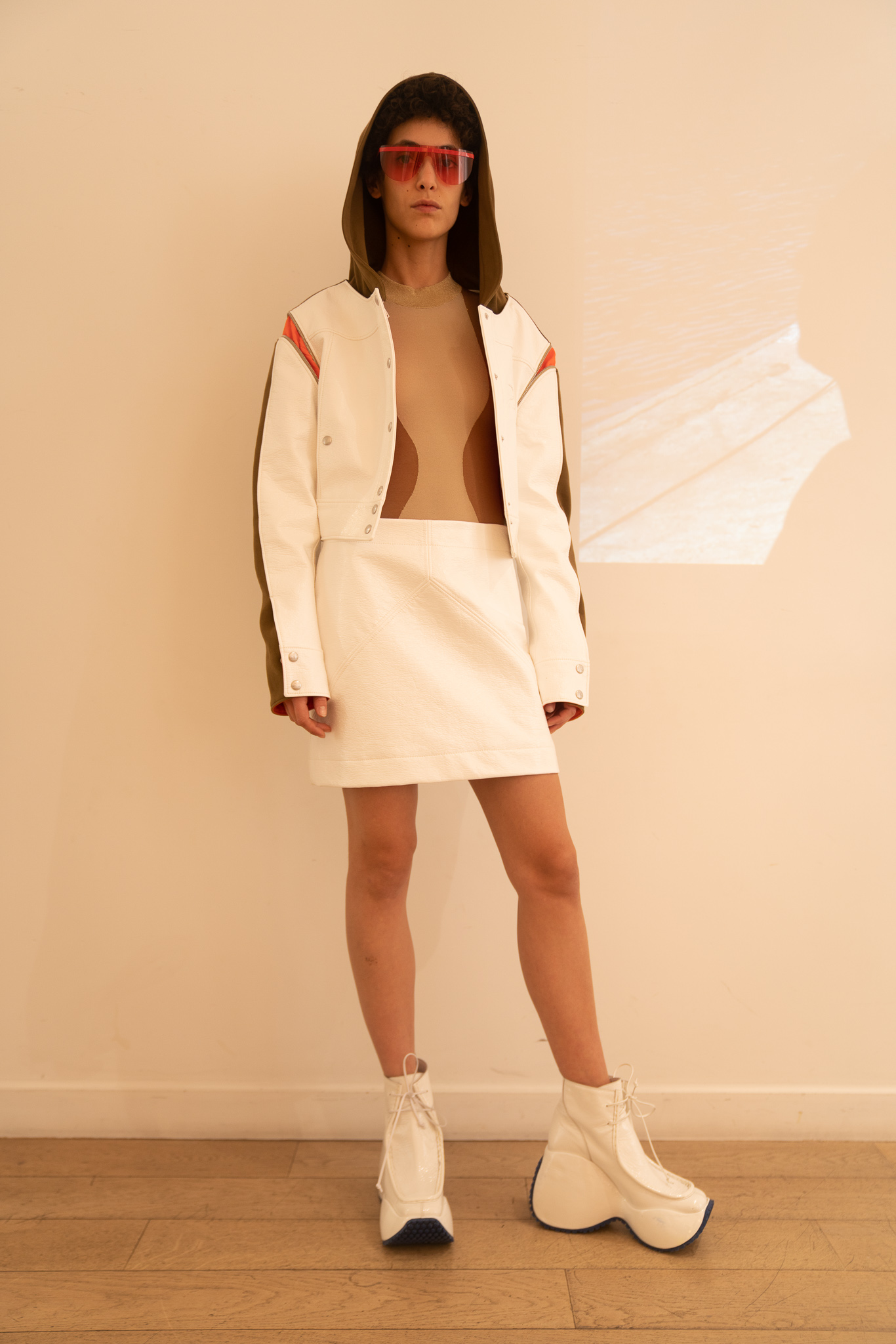 Courreges Hooded Multi Colored Jacket Undershirt in Brown Mini Skirt in White SS20