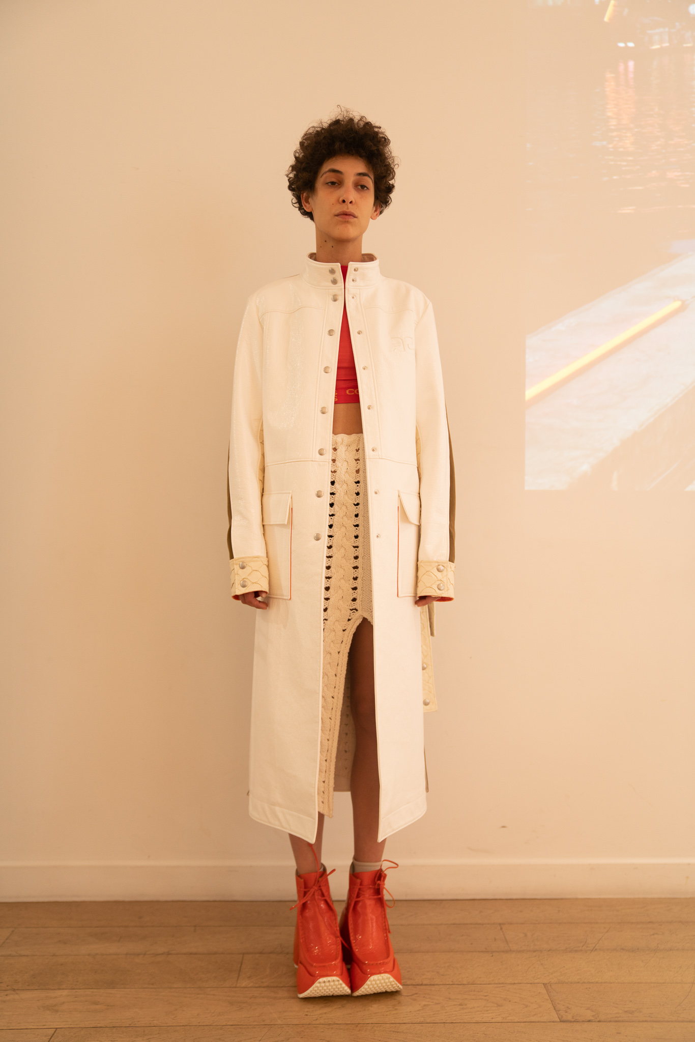 Courreges High Collared Coat in White Crop Top in Pink Slit Skirt in Yellow Platform Shoes in Pink SS20
