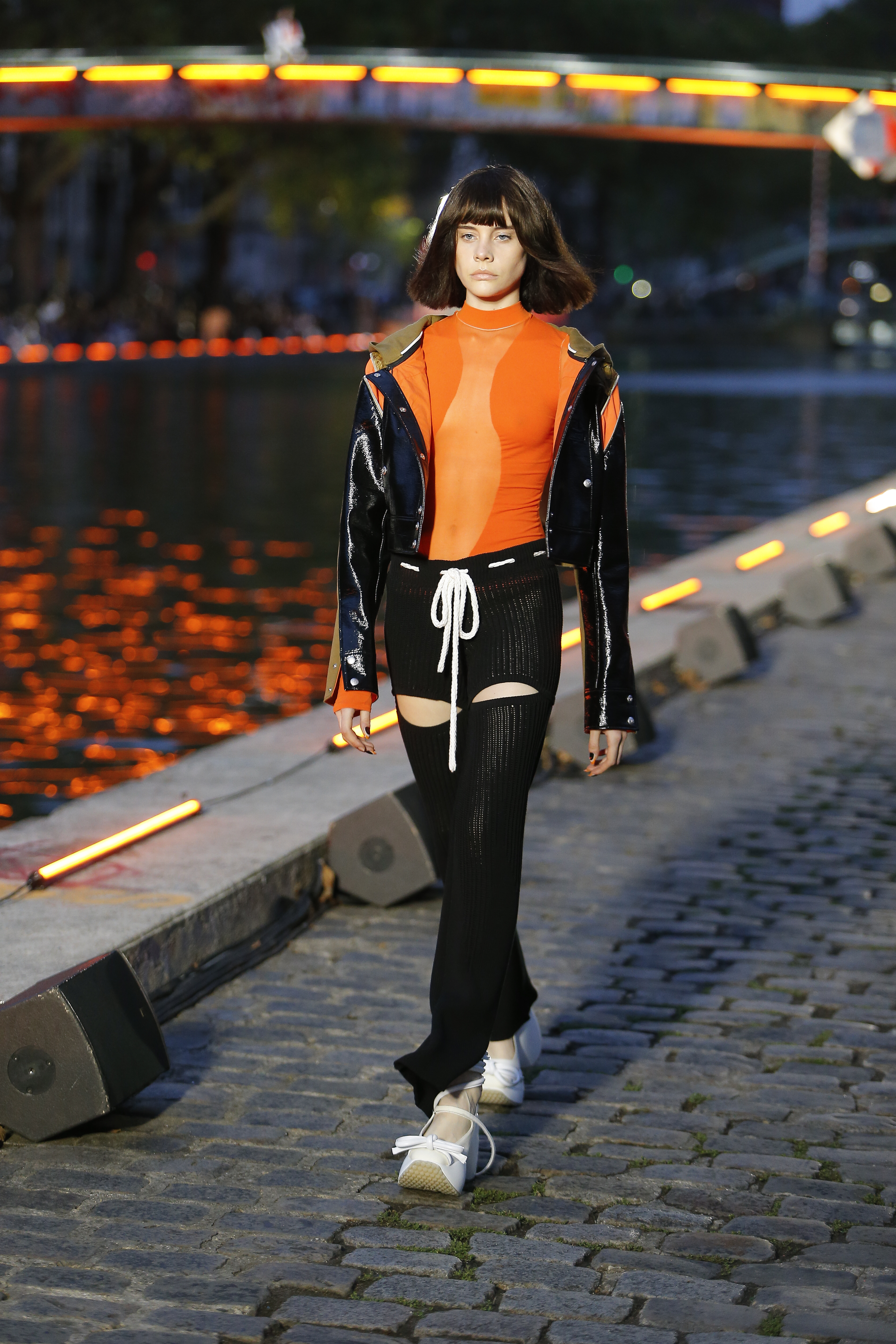 Courreges Runway Transparent Silhouette Long Sleeved Top in Orange Contrast Hooded Jacket Drawstring Slit Cotele Pants in Black SS20