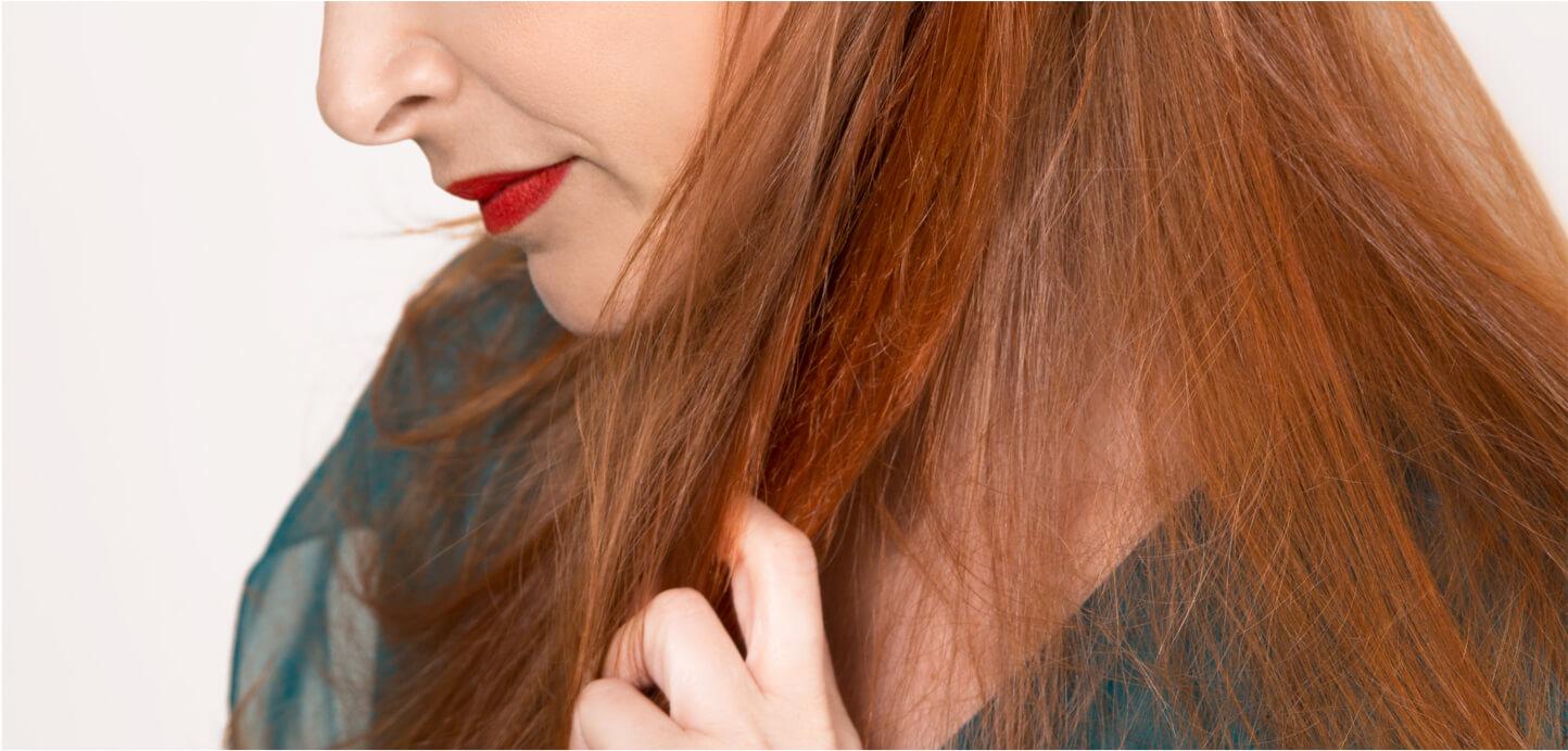 Girl touching soft, healthy, undamaged hair