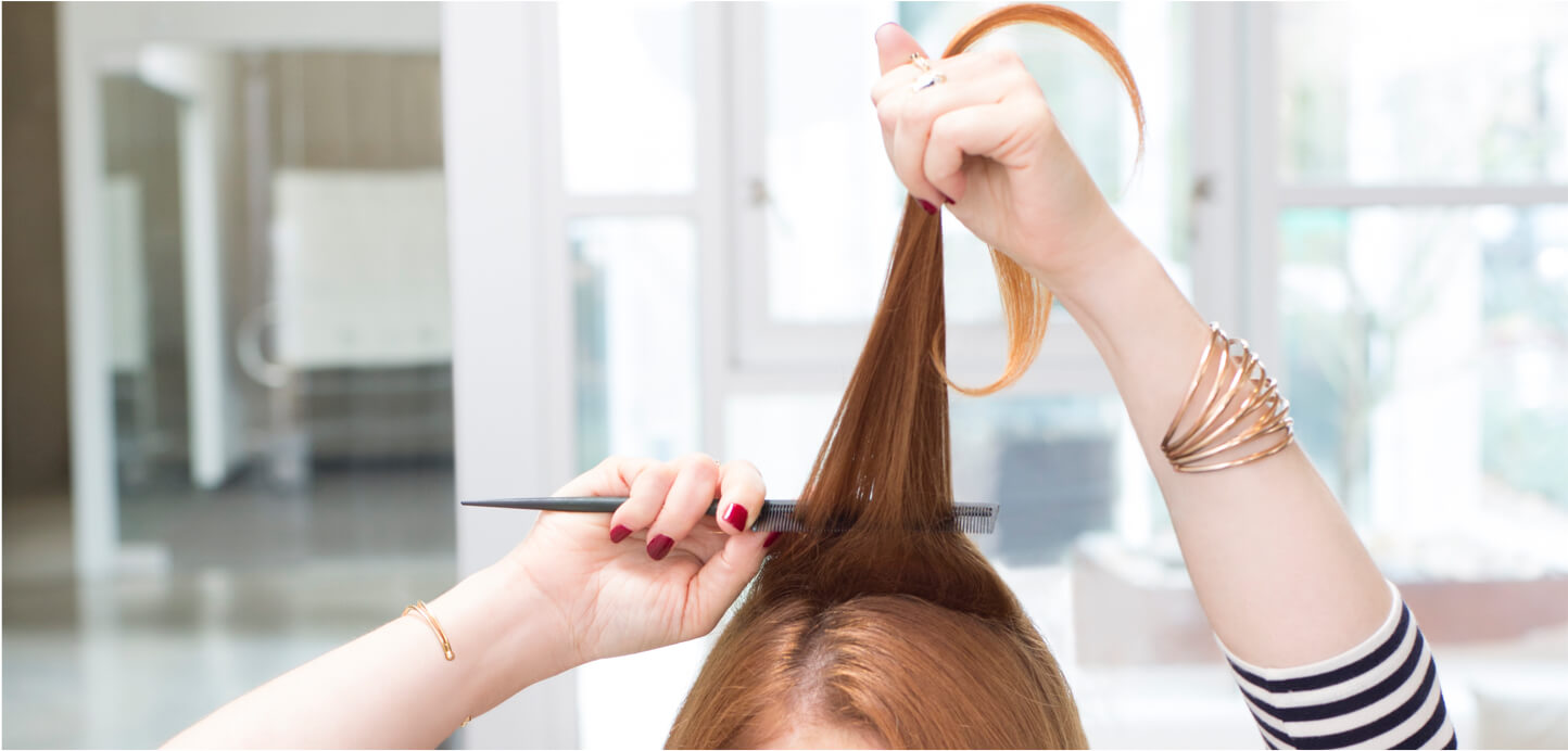 Girl teasing hair with fine-tooth comb