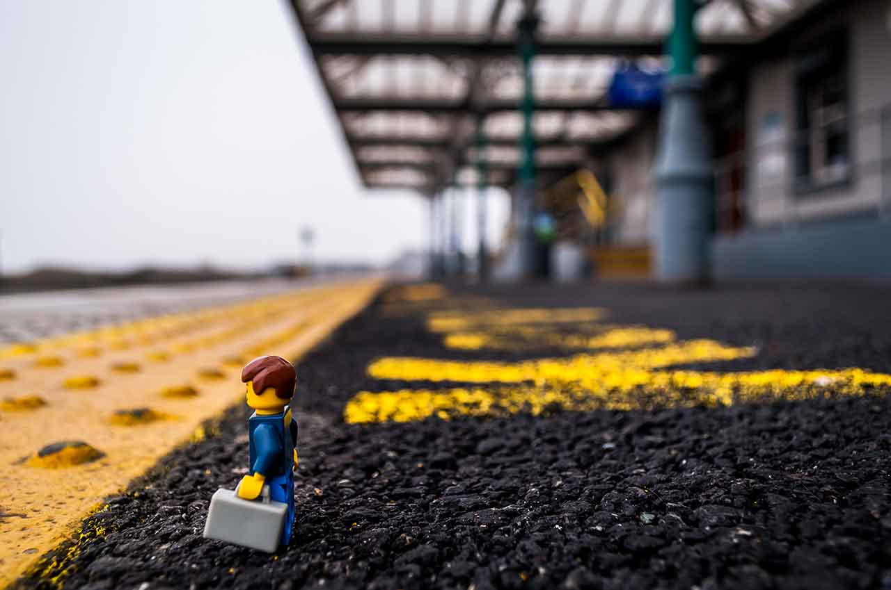 Lego man waiting for a train at Wexford Train station.
