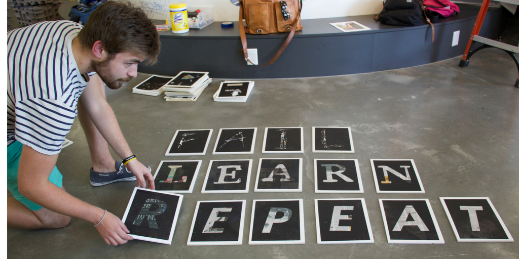 A sequence of paper with one letter on each that reads Fall, Learn, Repeat