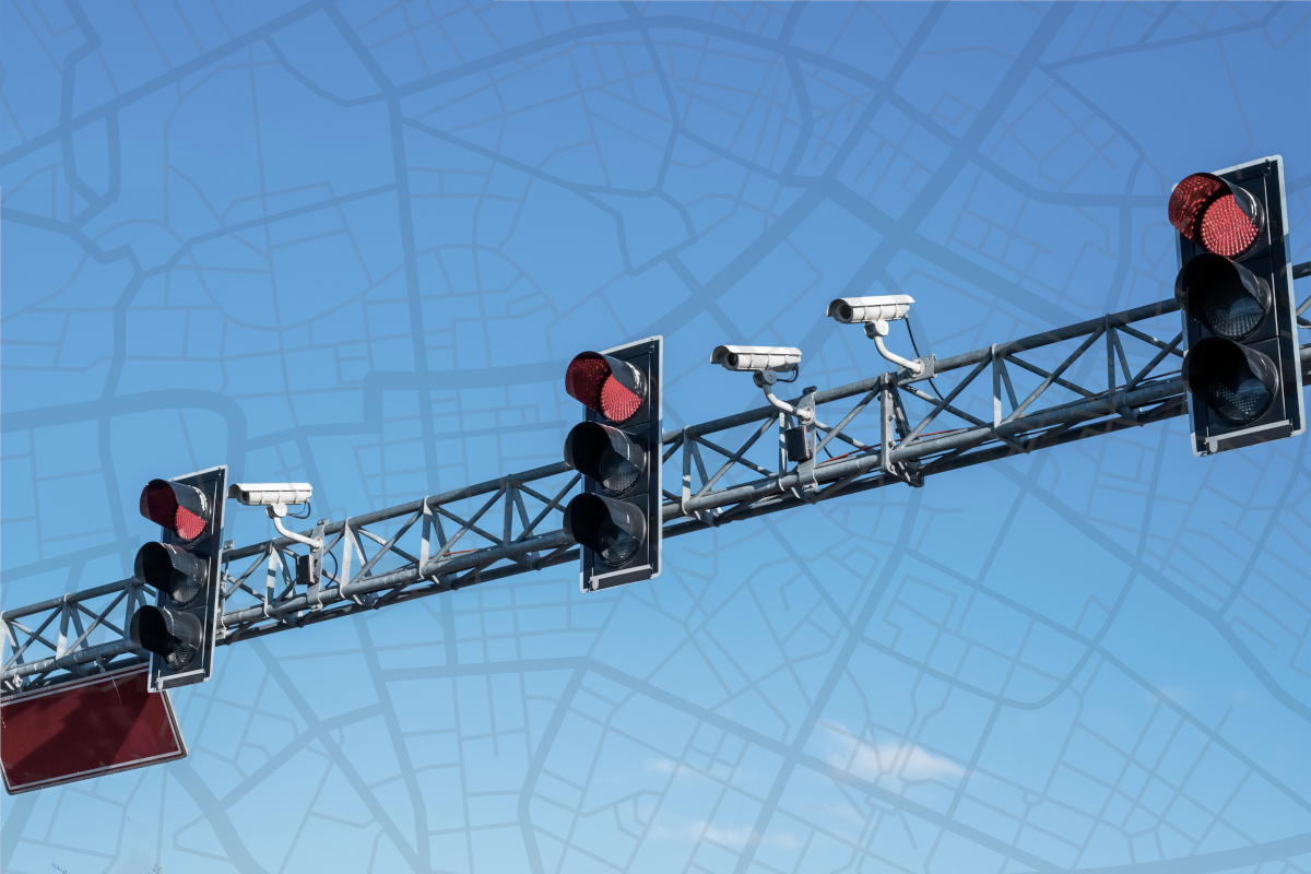 Red traffic lights with cctv cameras and city map overlay