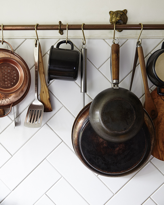 Hang frequently-used pots and pans to save space in drawers.