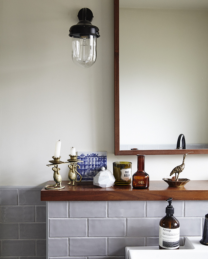 Outdoor wall lights used as statement lighting in a bathroom.