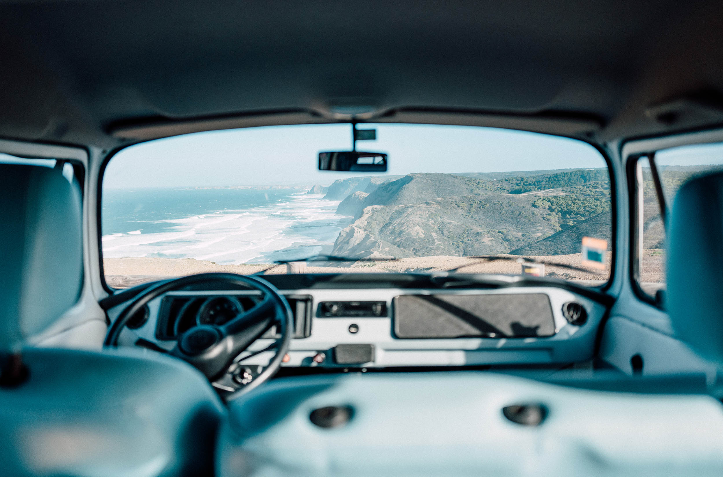 Idyllic Portugal coastline and top beach from the interior of a VW camper.