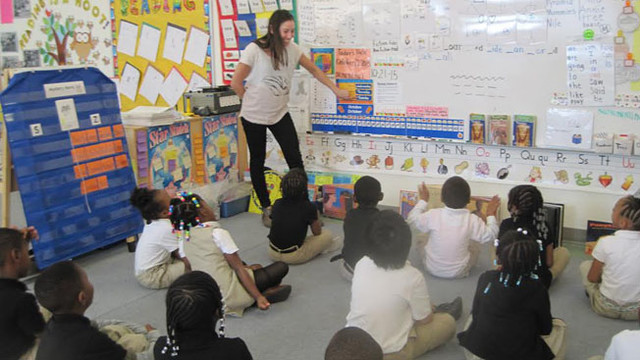 photograph of Daniela Silver teaching a group of students.