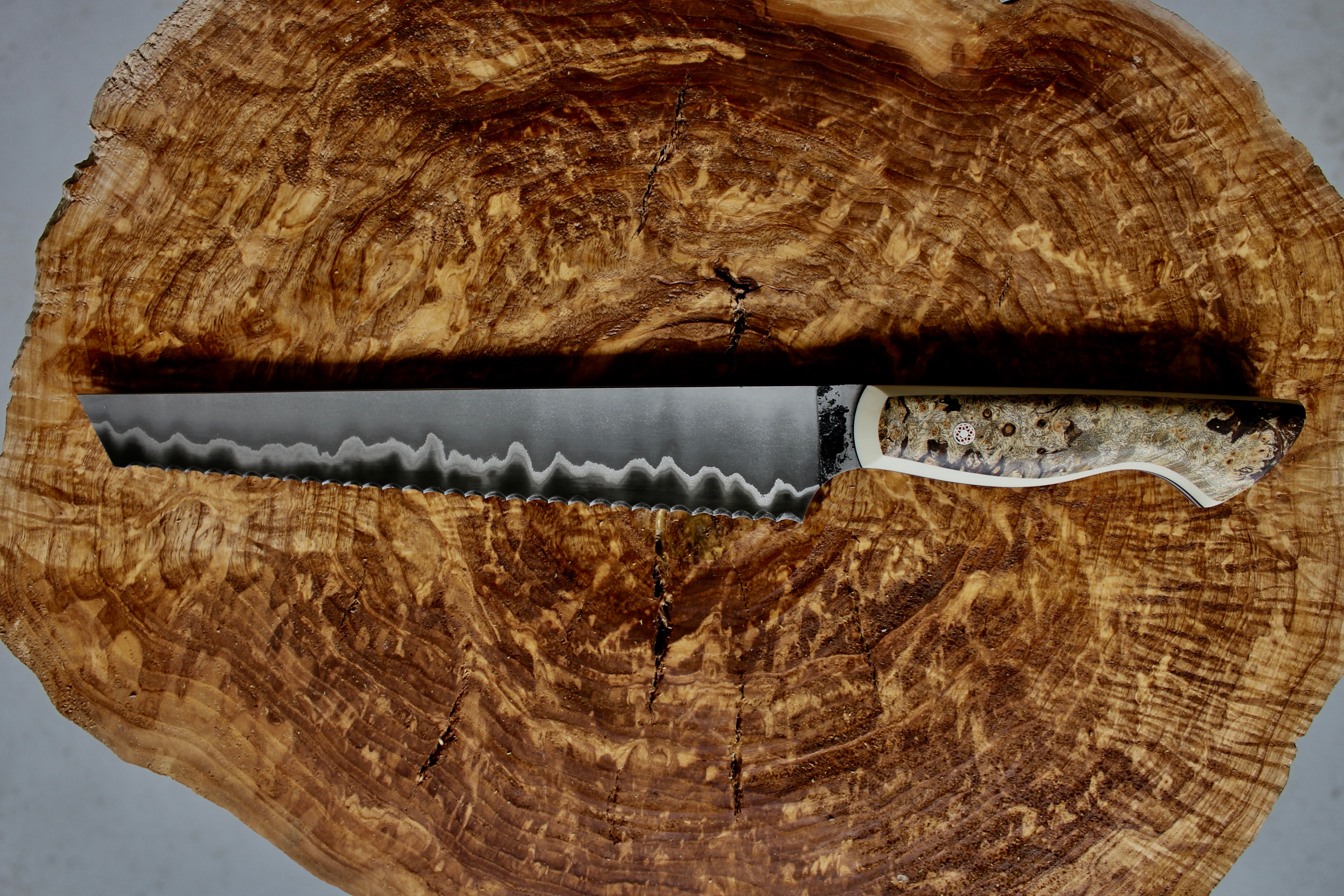 Custom knife with serrated edge from Culter in Toronto.
