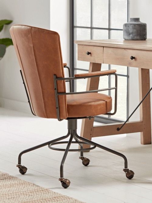 A brown leather office chair.