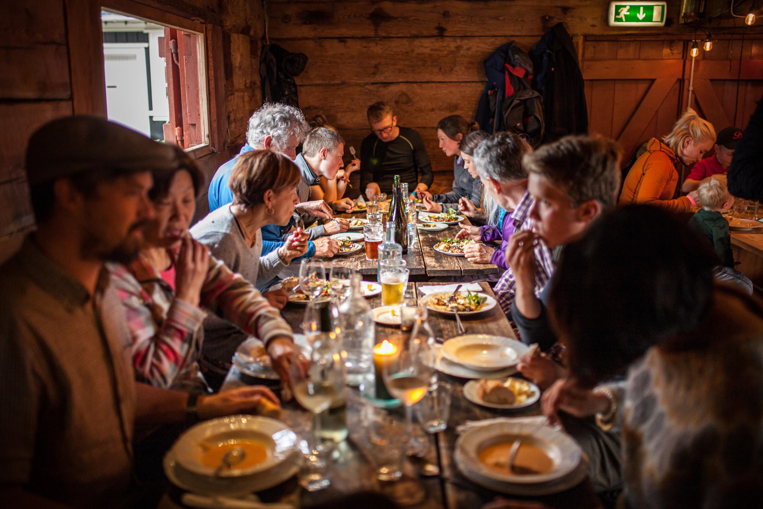 People dining at Tjöruhúsid restaurant in Ísafjördur