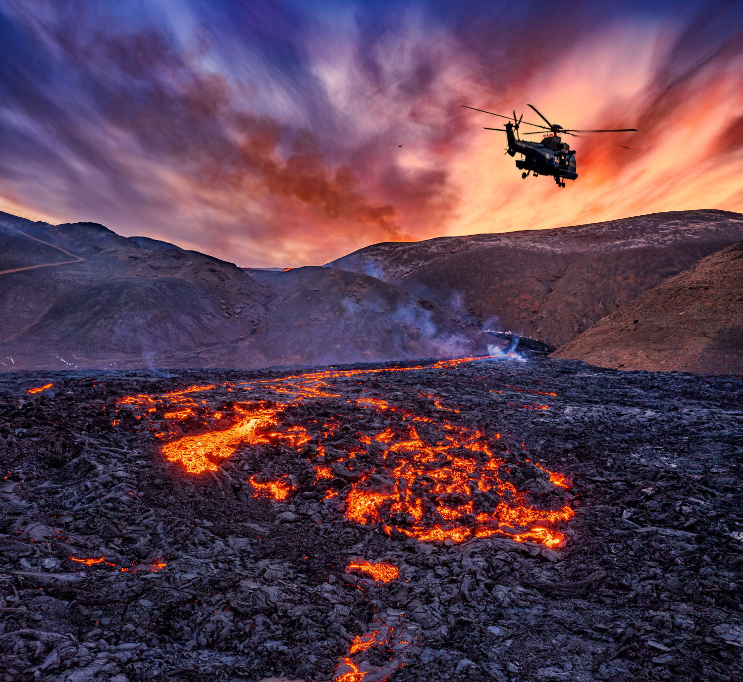 Helicopter hovering over the Fagradalsfjall volcano