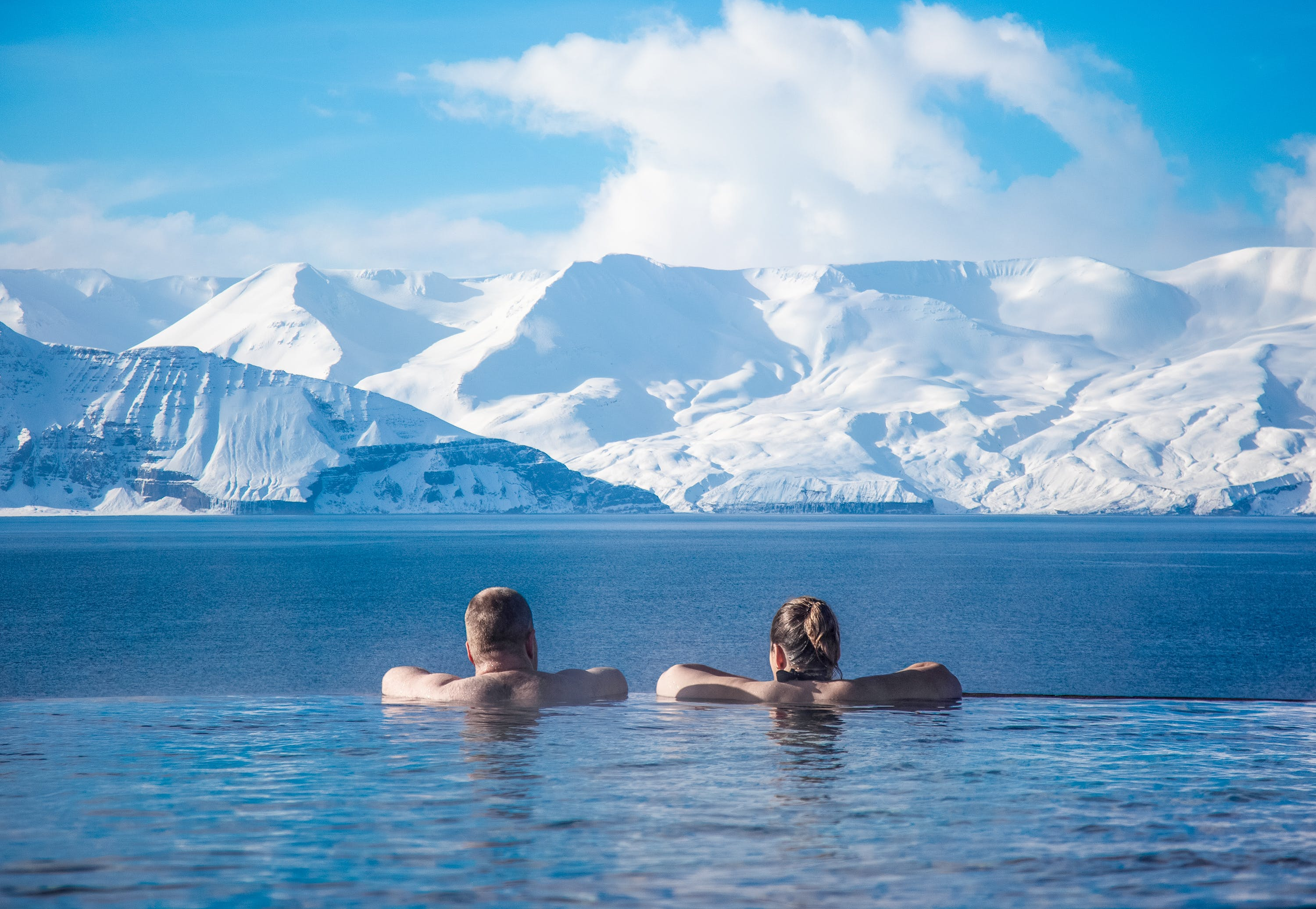 People bathing in Geosea with a mountain view