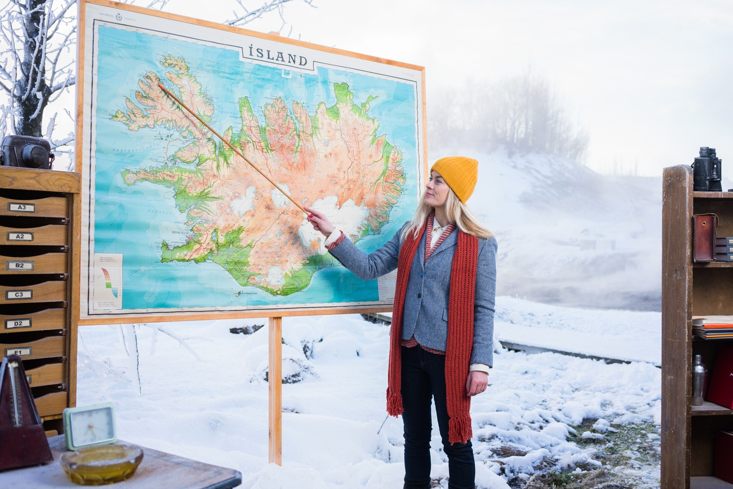 A woman pointing at a map of Iceland
