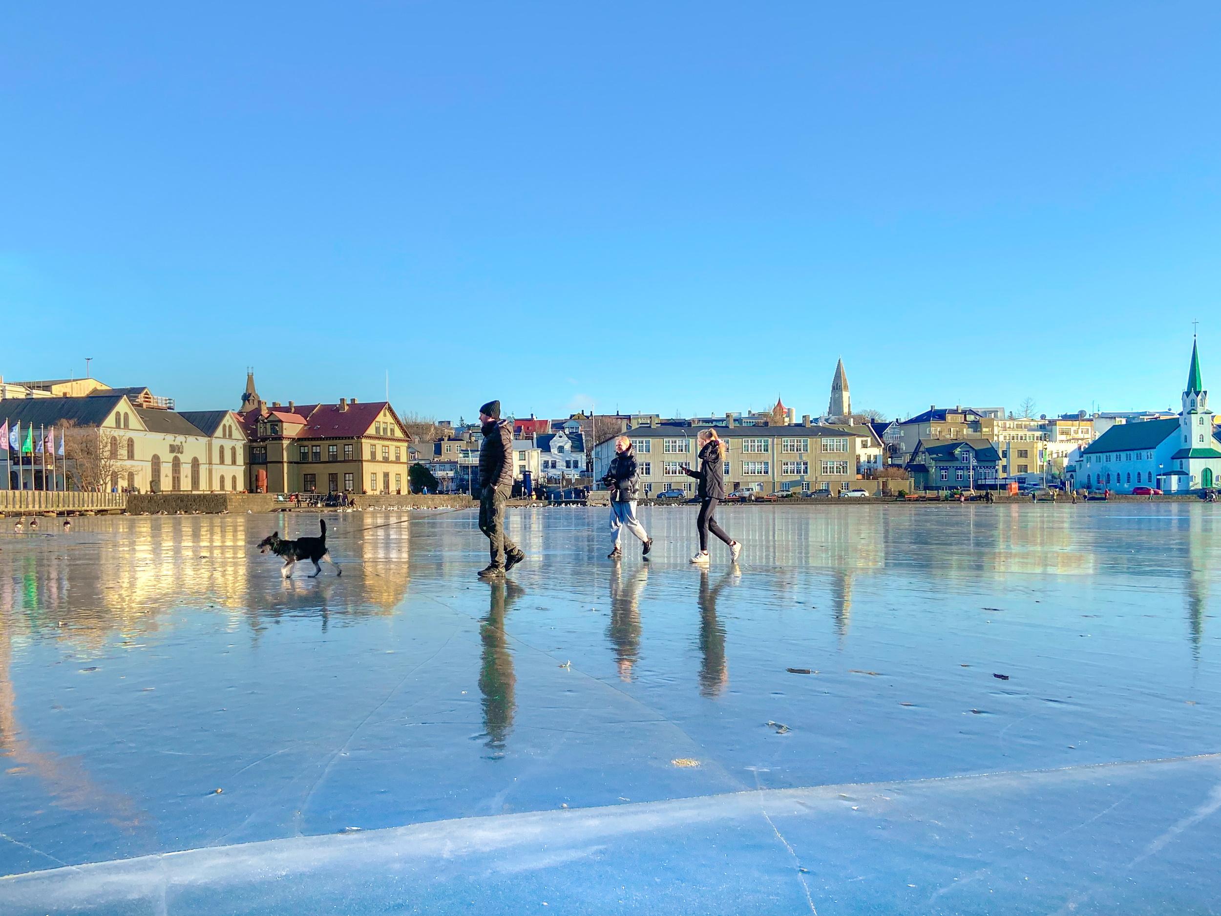 People walking on Reykjavik pond in winter