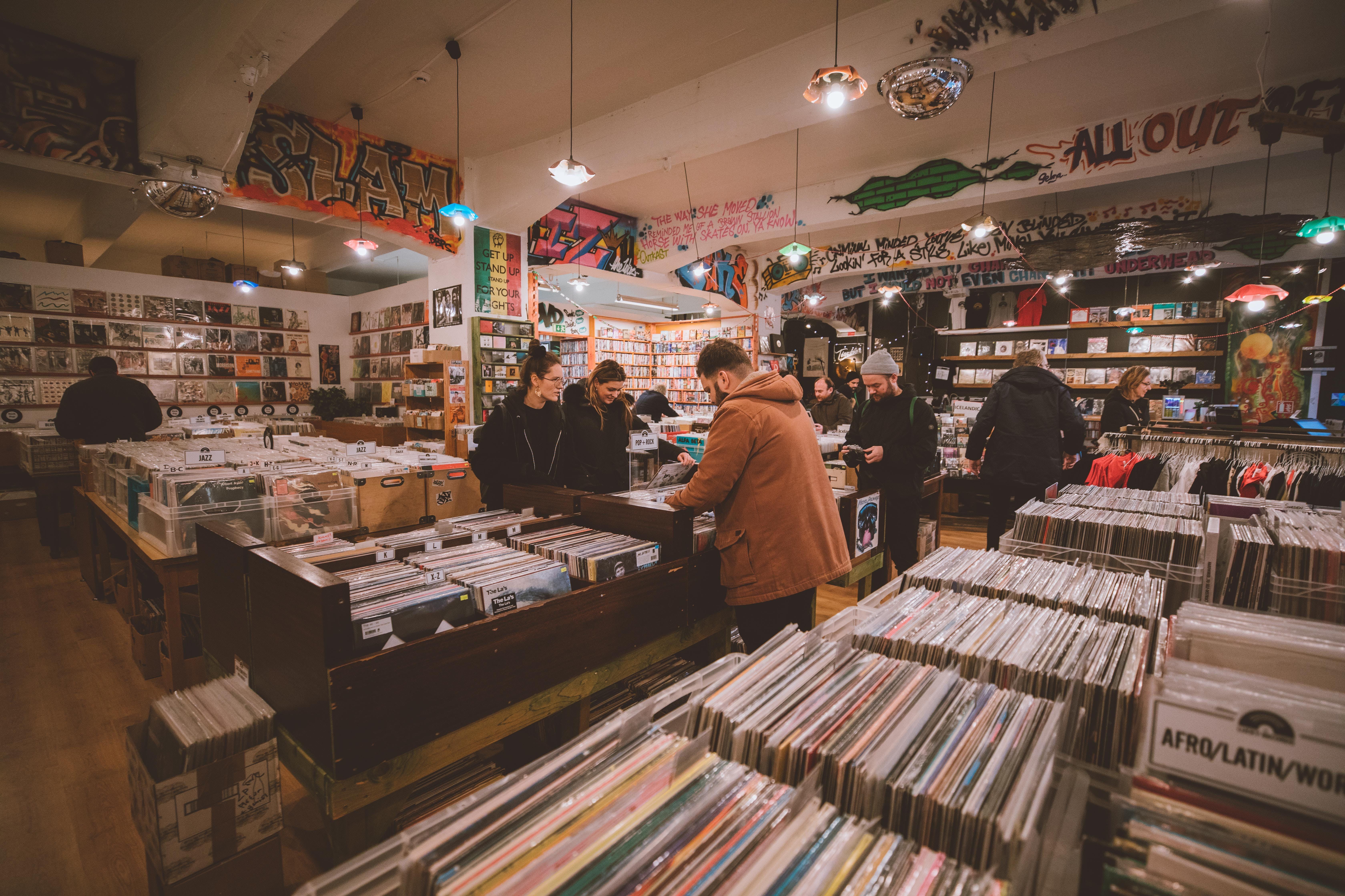 People browsing through records in a record store