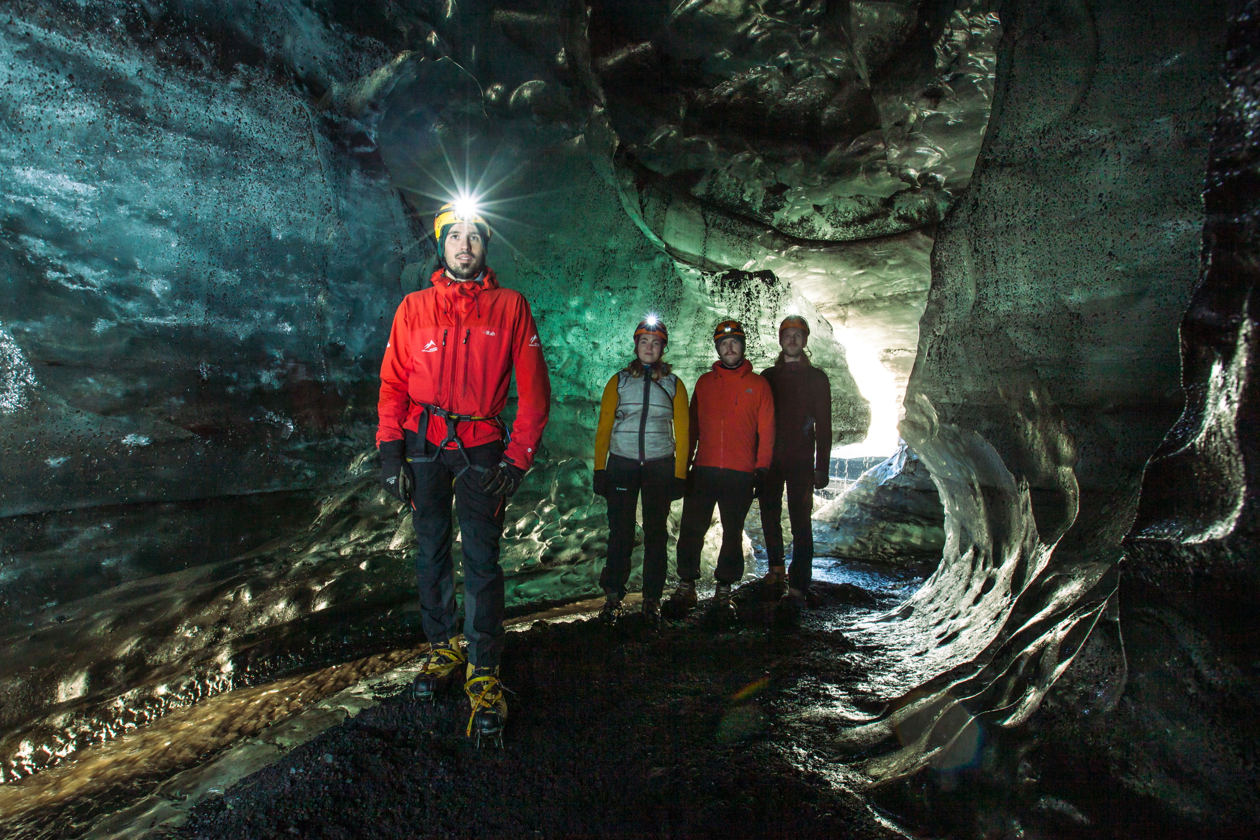 People exploring a cave in Iceland