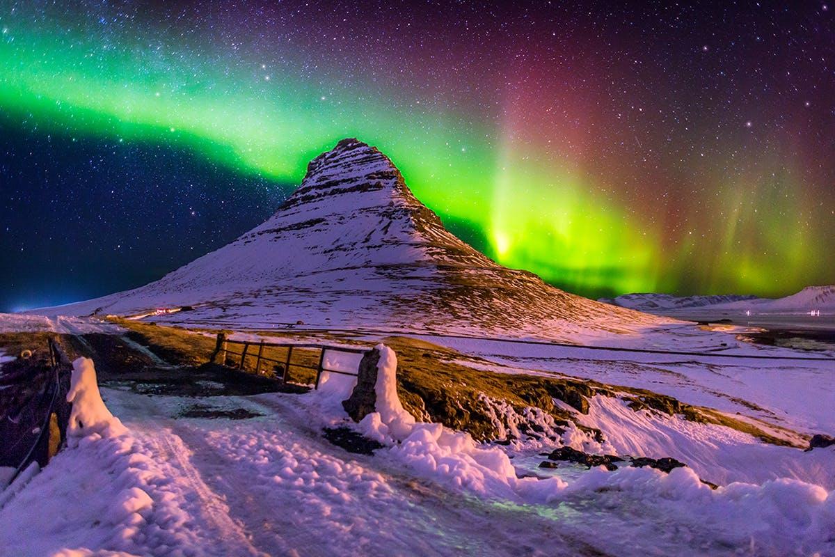 Northern lights dance above Kirkjufell mountain