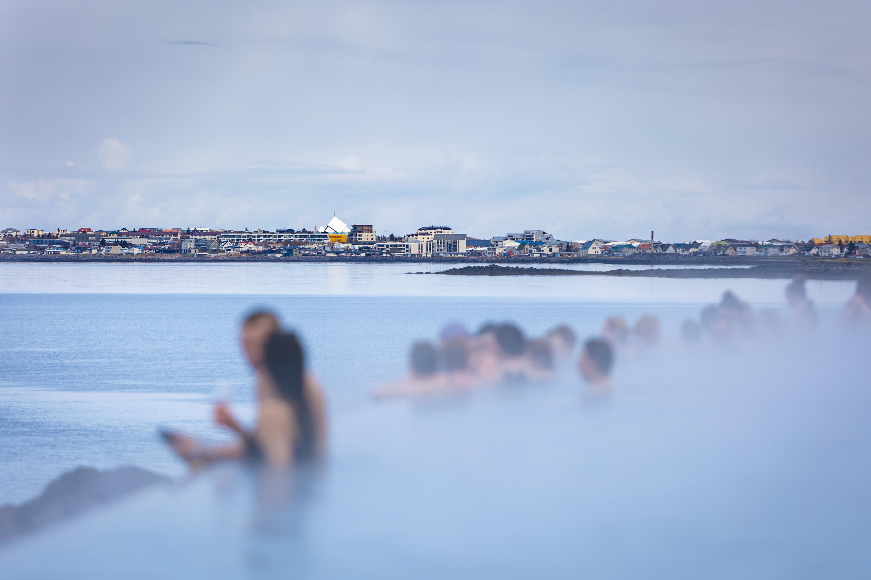 People bathing in Sky Lagoon