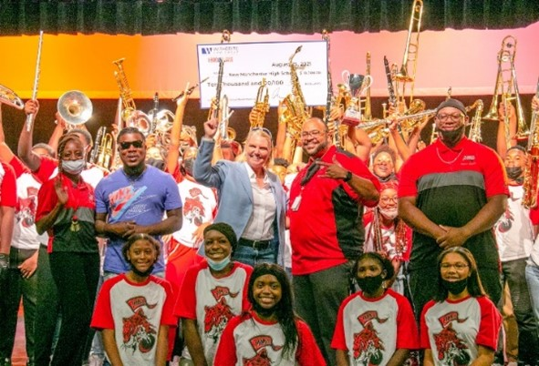 Amy Witherite and 1-800-TruckWreck awarded $10,000 to New Manchester High School as part of the 2021 (Inaugural) 1-800-TruckWreck Great Atlanta High School Band Challenge.