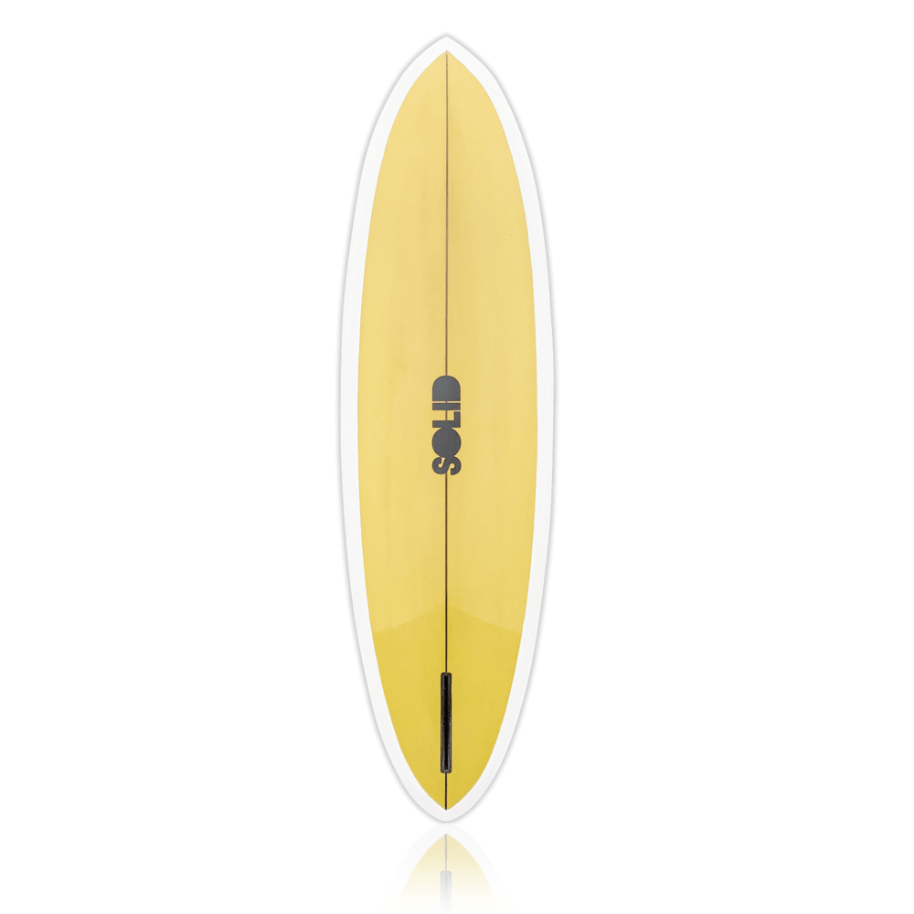 A yellow surfboard with the SOLID logo in the middle.
