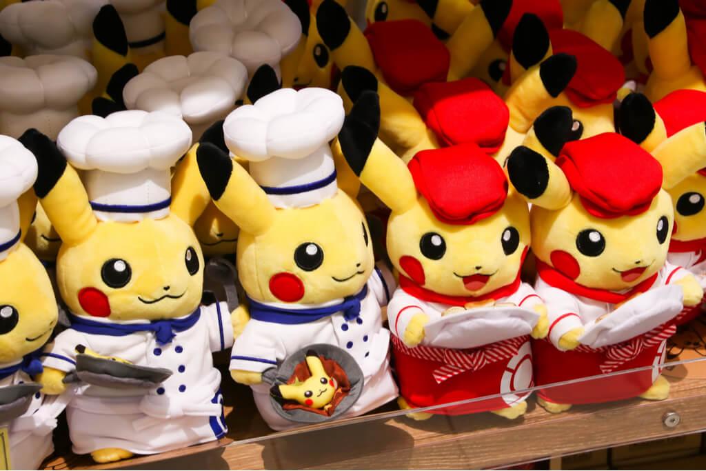 Chef Pikachu and Waitress Pikachu plushies on a shelf.
