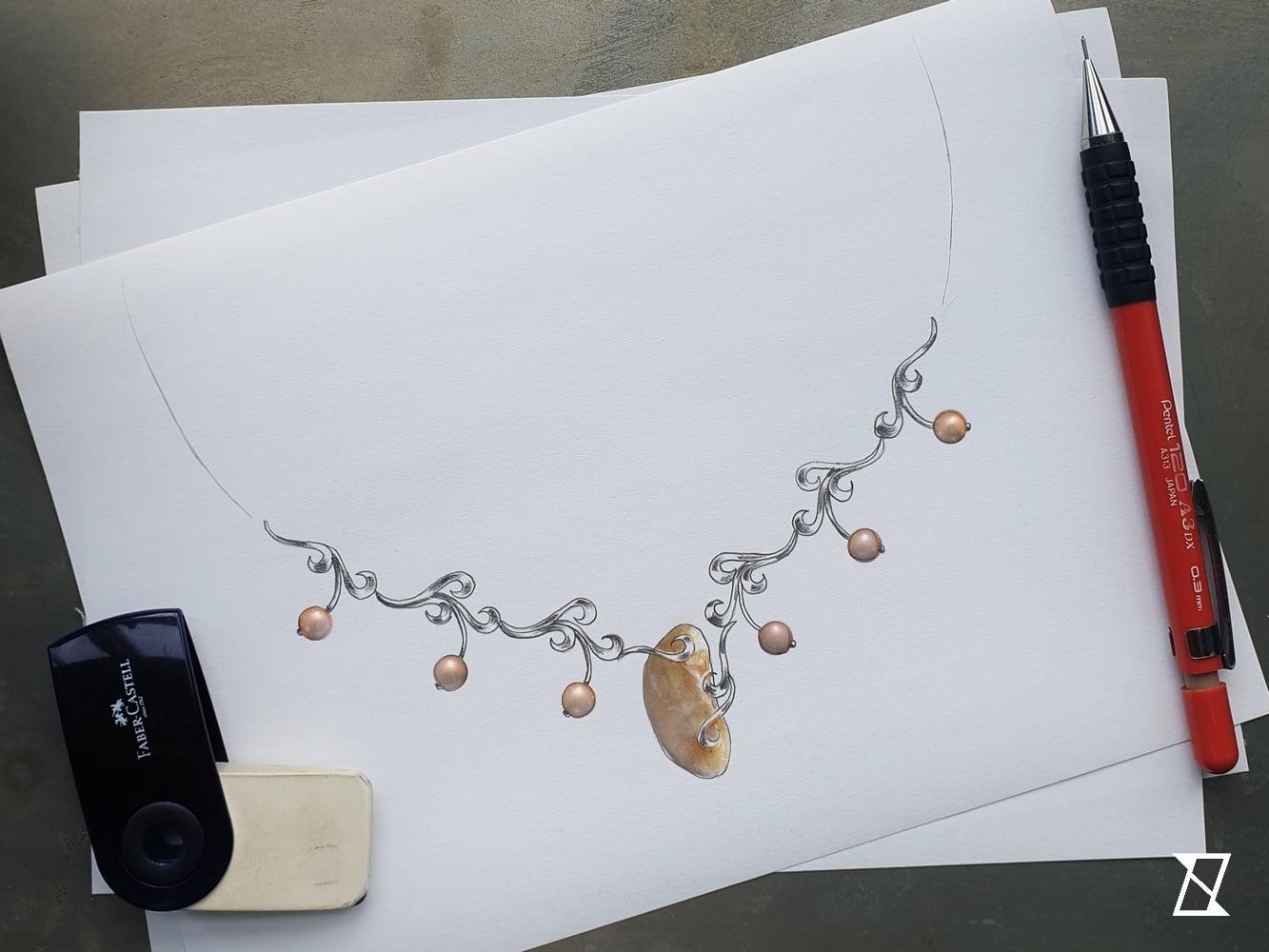 Autorski projekt biżuterii z perłami i bursztynem.